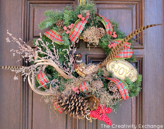 Christmas wreath mixed with Spanish moss, pine cones and antlers {The Creativity Exchange}