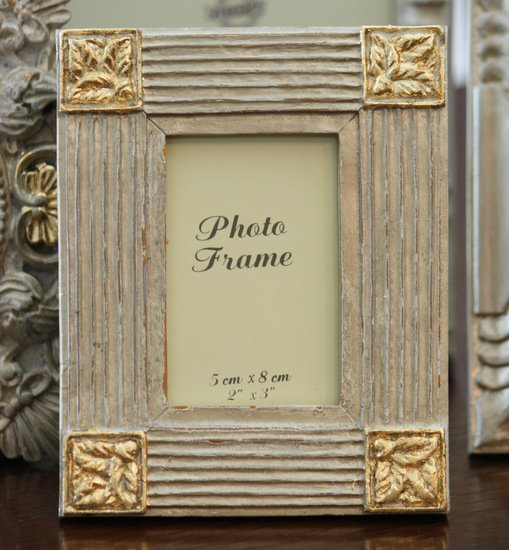 Tutorial for transforming old frames with spray paint & gold leaf