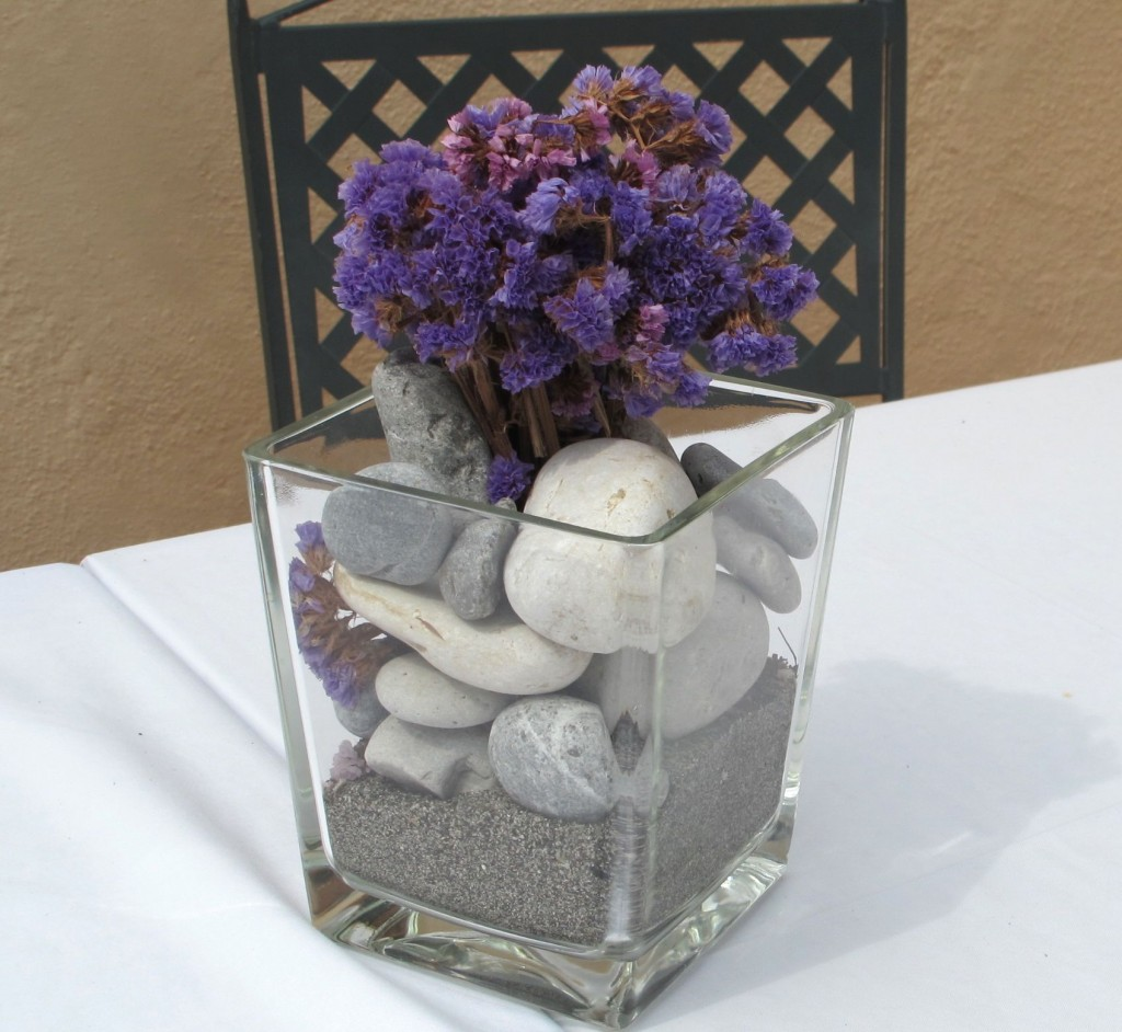 Fill a vase with rocks and add flowers