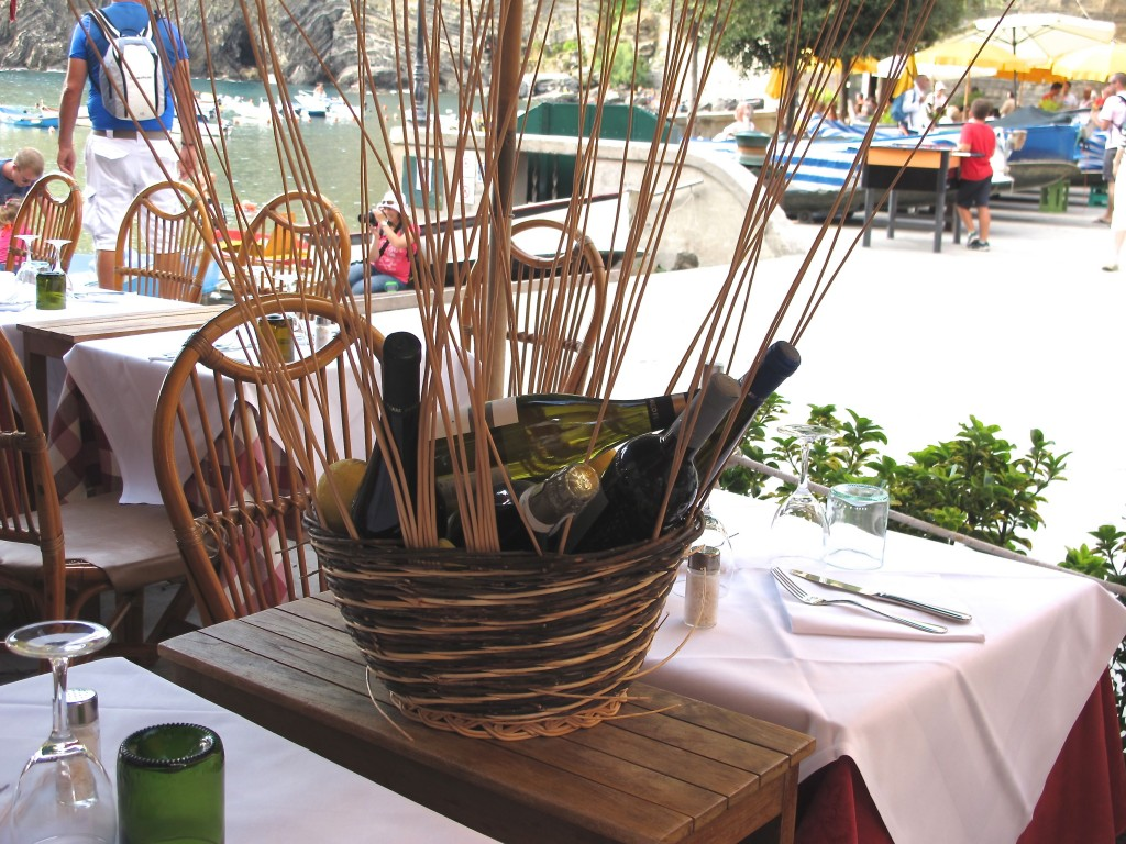 Fill basket with bottles of wine and sticks for Italian centerpiece