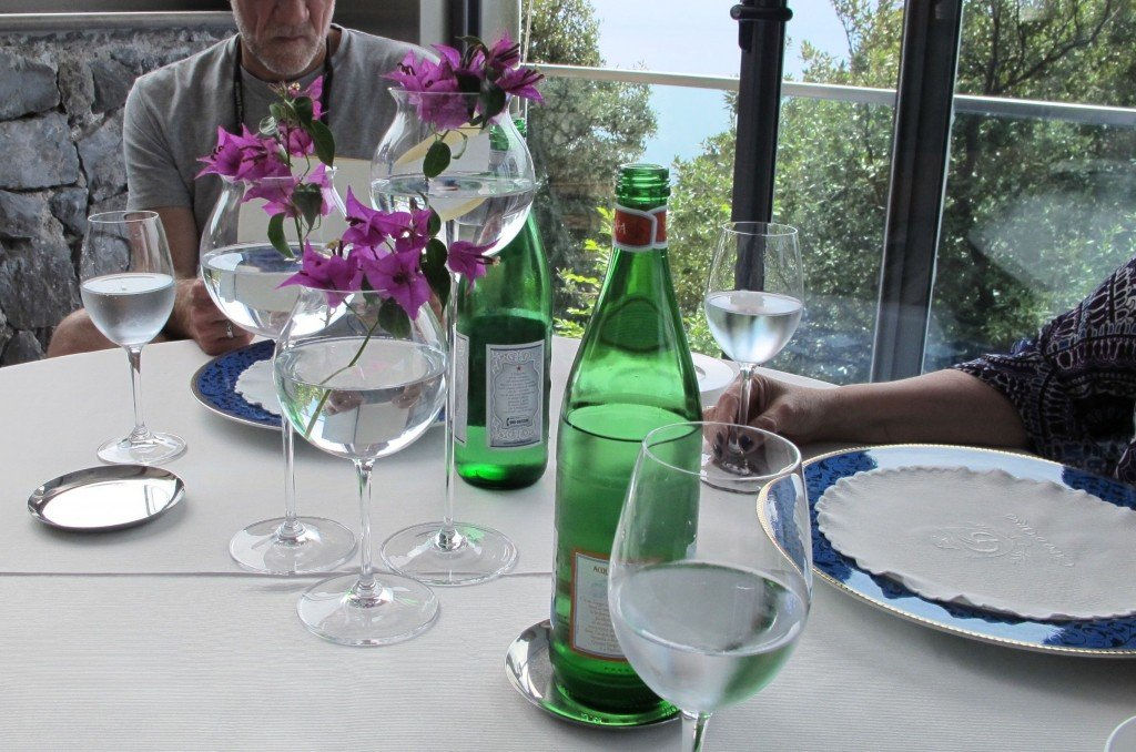 Wine glasses in different sizes with flowers. (Italy Inspiration)