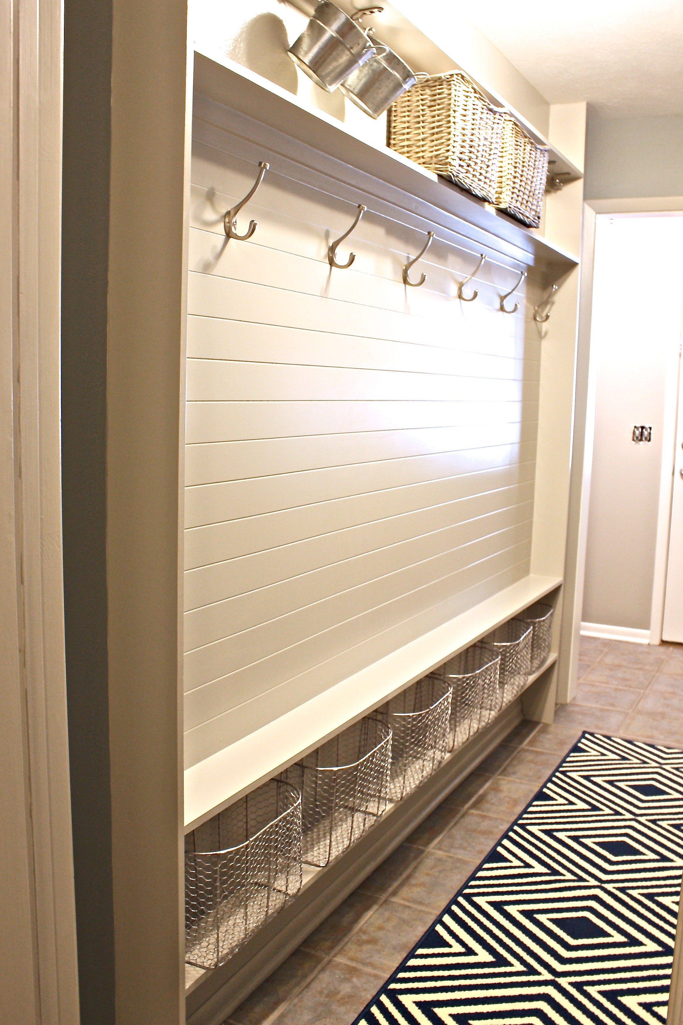 Stairwell and mudroom revamp before and after for Great storage