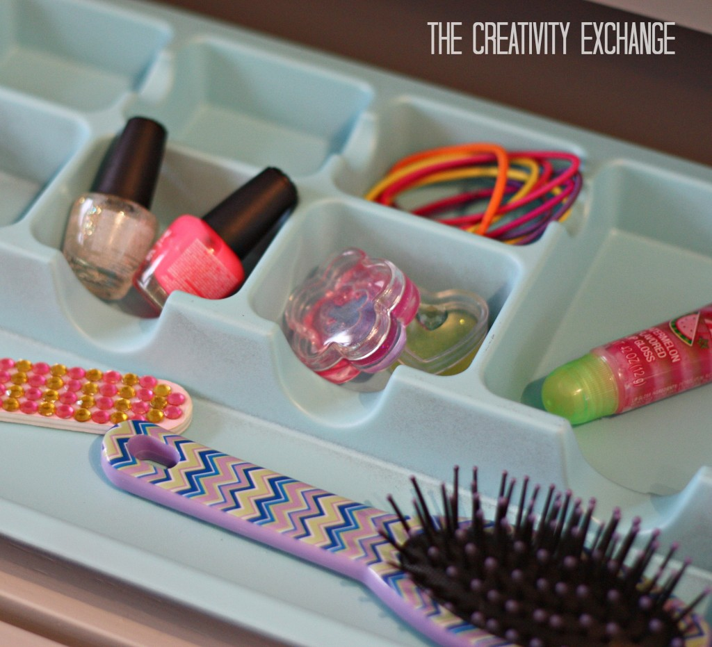 spray paint cheap drawer organizers in metallics or fun colors for pretty makeup and desk drawers {Paint It Monday} The Creativity Exchange