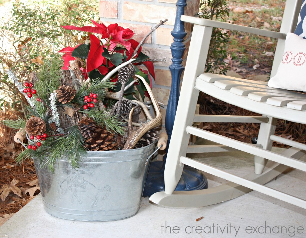 Fill beverage bucket with pine cones, wood and pine cuttings for a festive front porch {The Creativity Exchange}