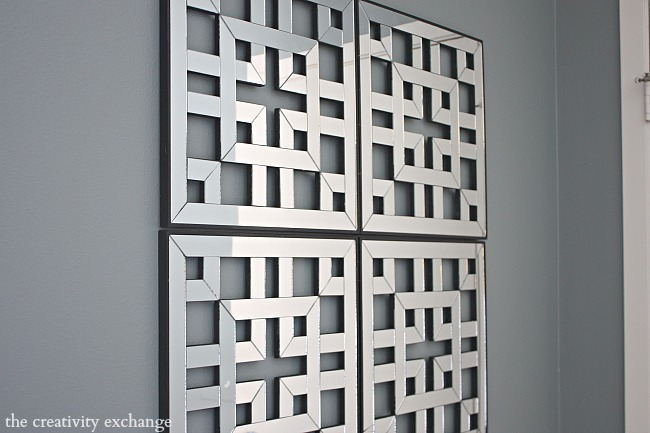 fret work mirrored panel squares attached together to create large statement piece.  Mirror squares are from Kirkland's- The Creativity Exchange