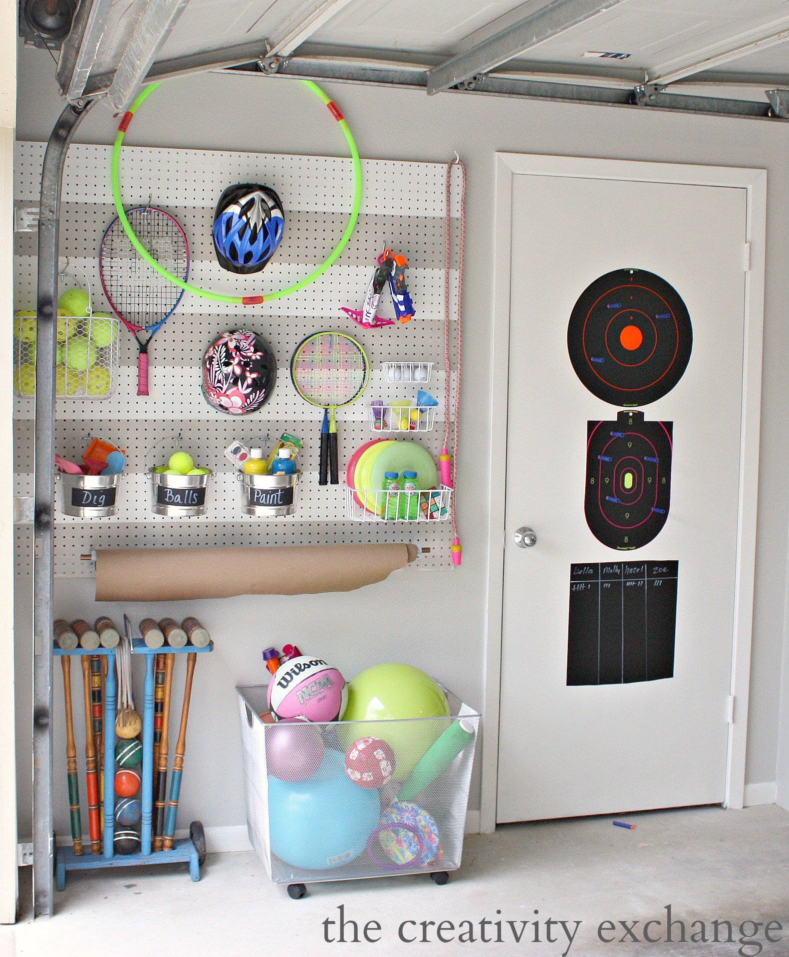 Diy garage pegboard storage for outdoor toys for Diy wall storage