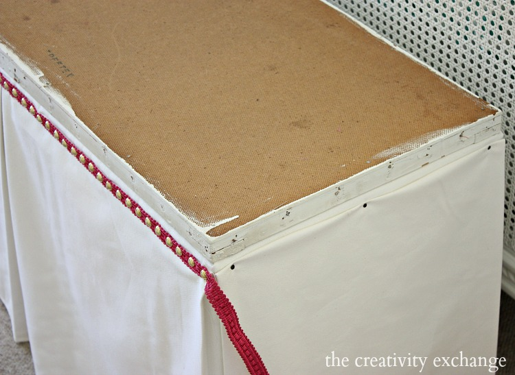 Tutorial for recovering benches and ottomans by using faux panel trick.  The Creativity Exchange