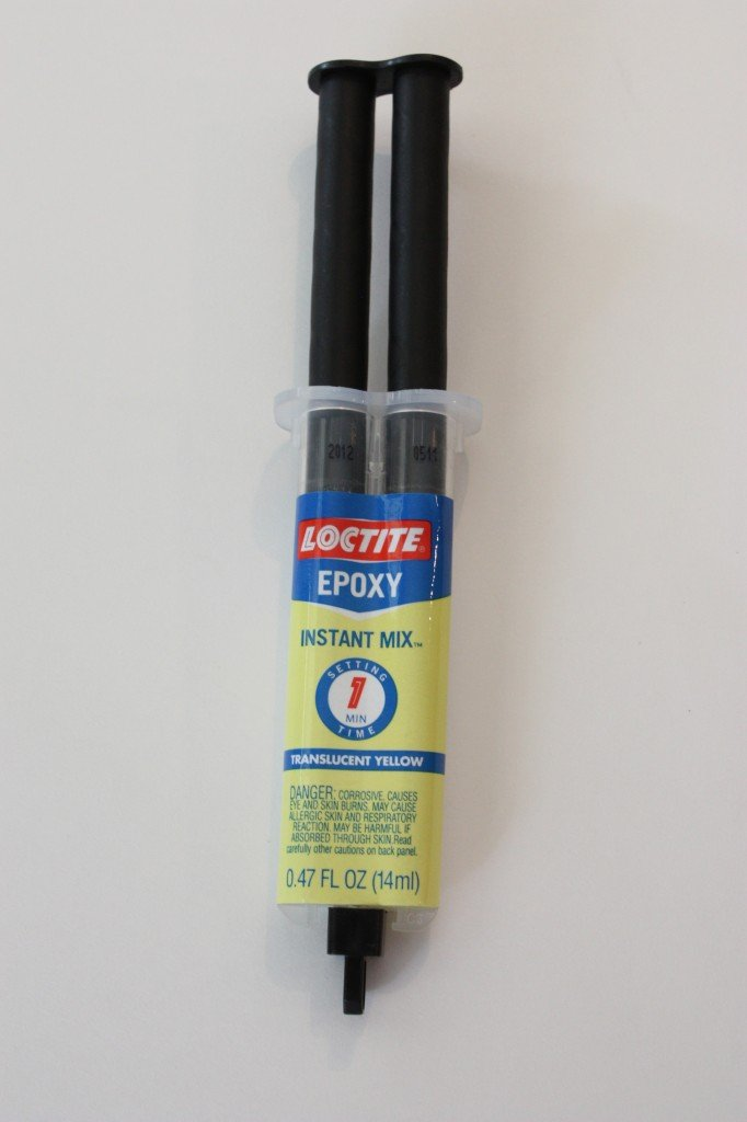 Loctite Epoxy is by far the best glue on the market for gluing things to glass.  The Creativity Exchange