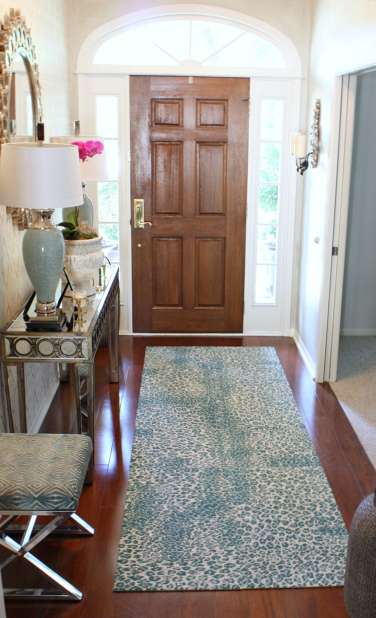 Teal animal print rug is carpet squares from flor that are attached