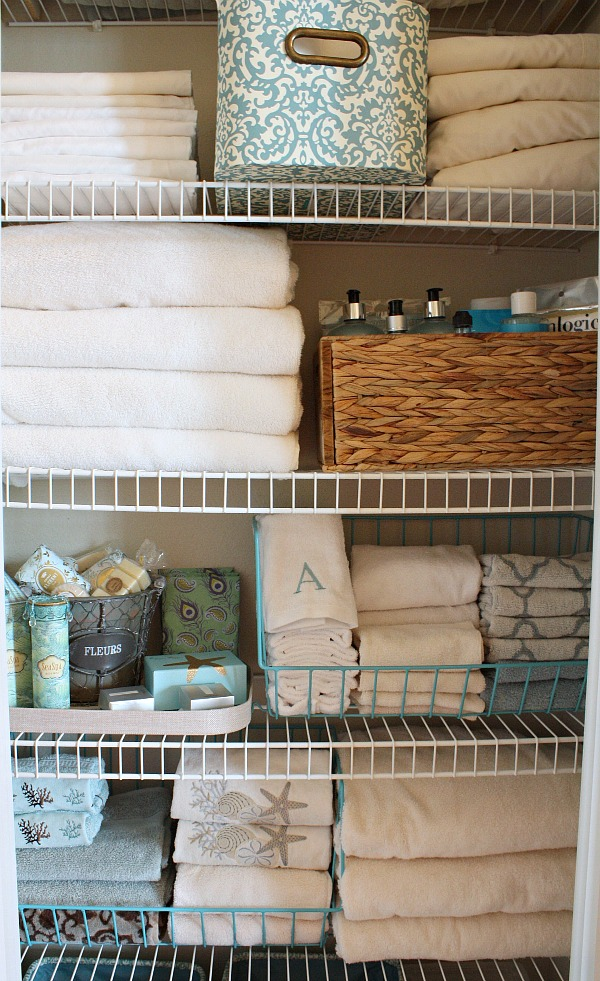 Organized linen closet. Storage pieces from Kirklad's The Creativity Exchange
