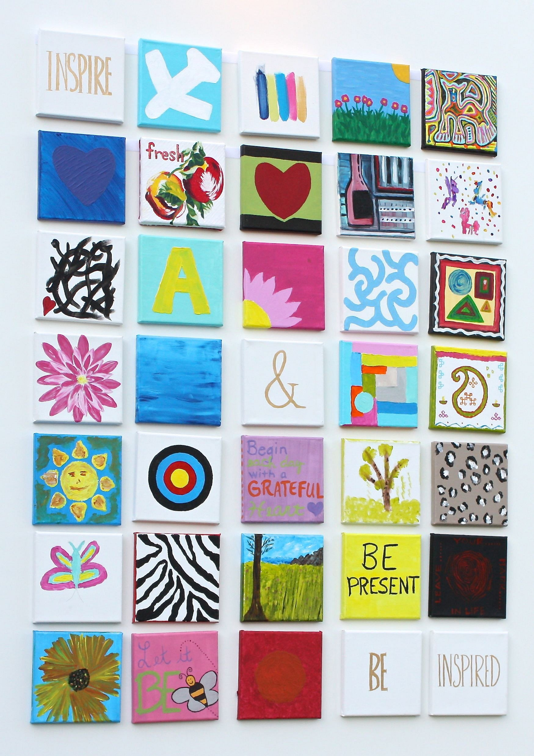 Small paintings gallery wall idea for home. Everyone paints a small canvas. The Creativity Exchange
