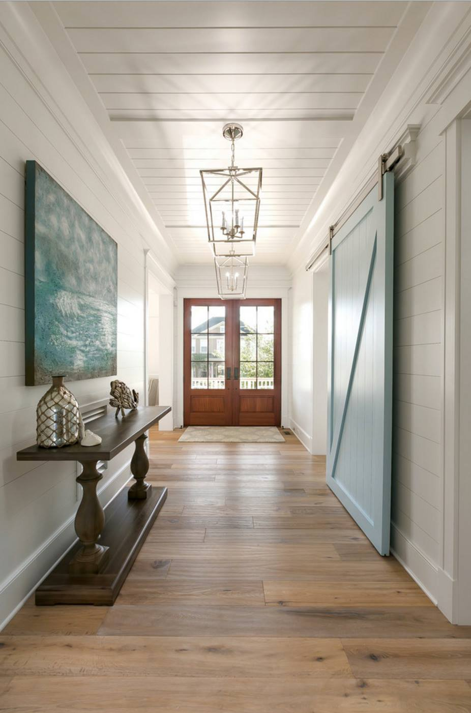 Wall color is Sherwin Williams Extra White and Barn Door Color is Yarmouth Blue Benjamin Moore. via The Guest House Studio