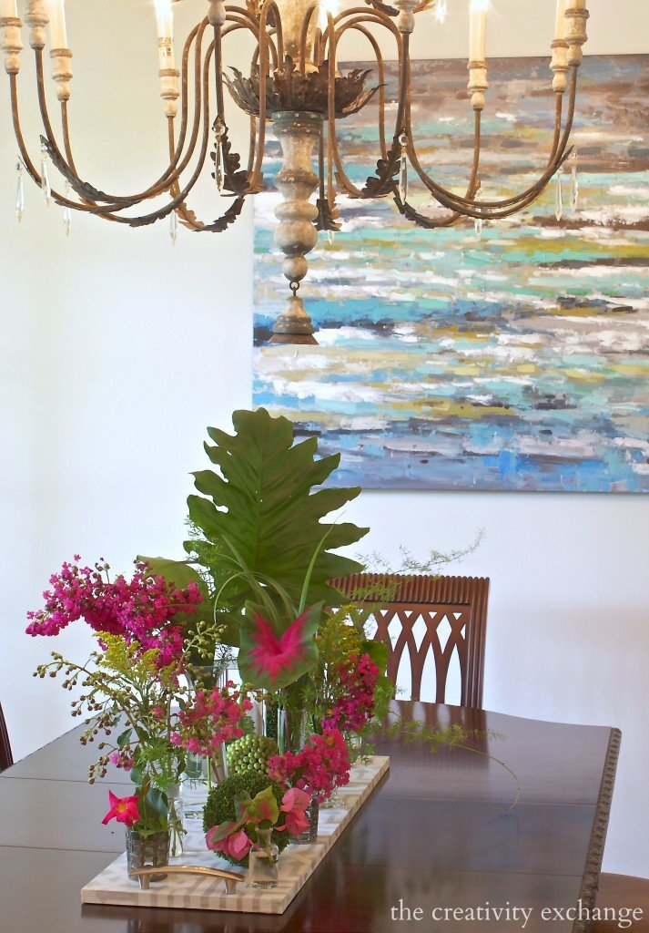 Use glass vases and candle holders in various sizes for summer clippings. The Creativity Exchange