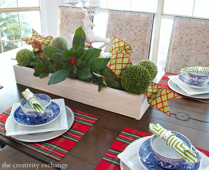 Christmas centerpiece using wood box, moss balls and fresh magnolia.  The Creativity Exchange
