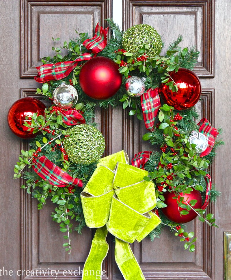 Front door wreath mix of candy apple green velvet and fresh Jaupon Holly. The Creativity Exchange