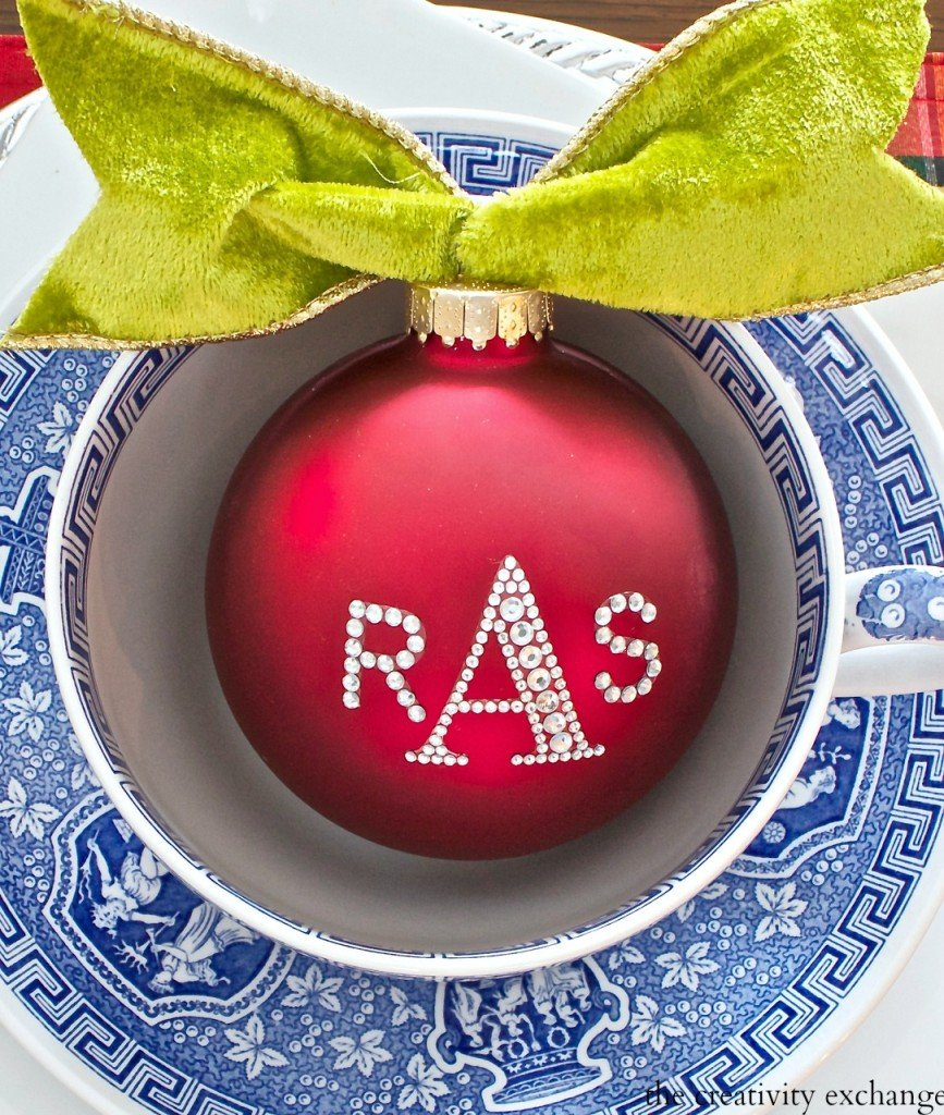 Use rhinestone sticker letters to personalize place settings.  An inexpensive and thoughtful gift idea.  The Creativity Exchange Christmas home tour.