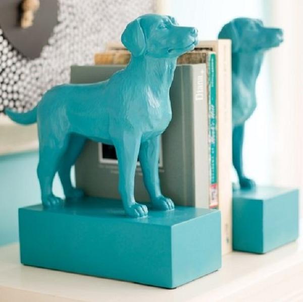 Glue plastic animals to wood blocks and spray paint.