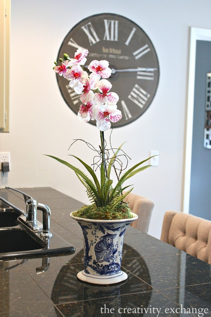 Trick for making silk orchids look real.