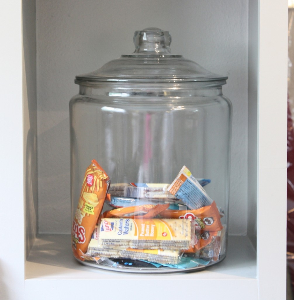 Use oversized glass cookie jars for storing quick snacks in family room.
