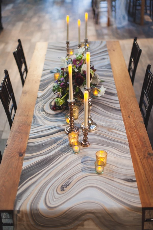 Have marbled papers laminated at office depot and turn into table runners or placemats.