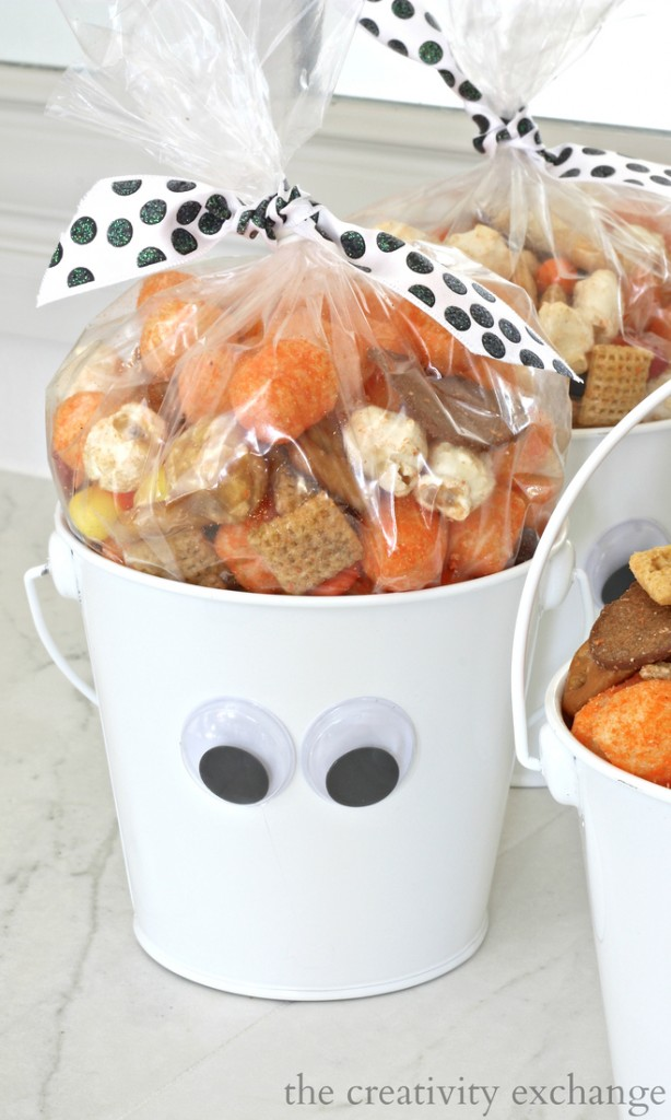 Add wiggly eyes to white buckets and fill with this Halloween snack mix recipe
