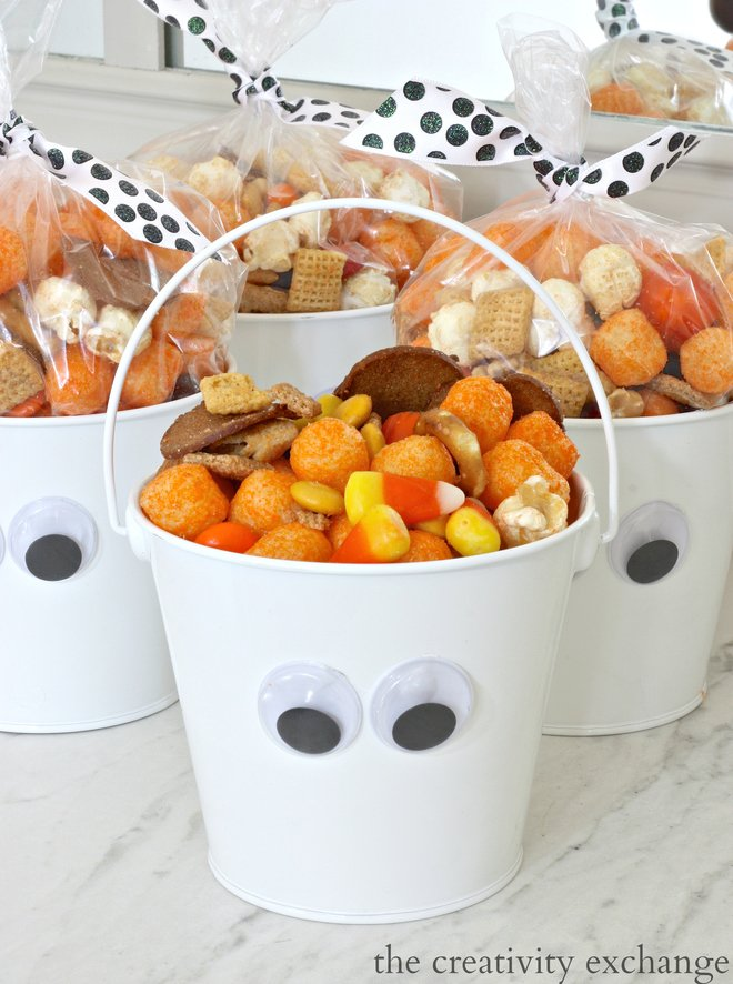 Add wiggly eyes to white buckets and fill with this Halloween snack mix recipe.