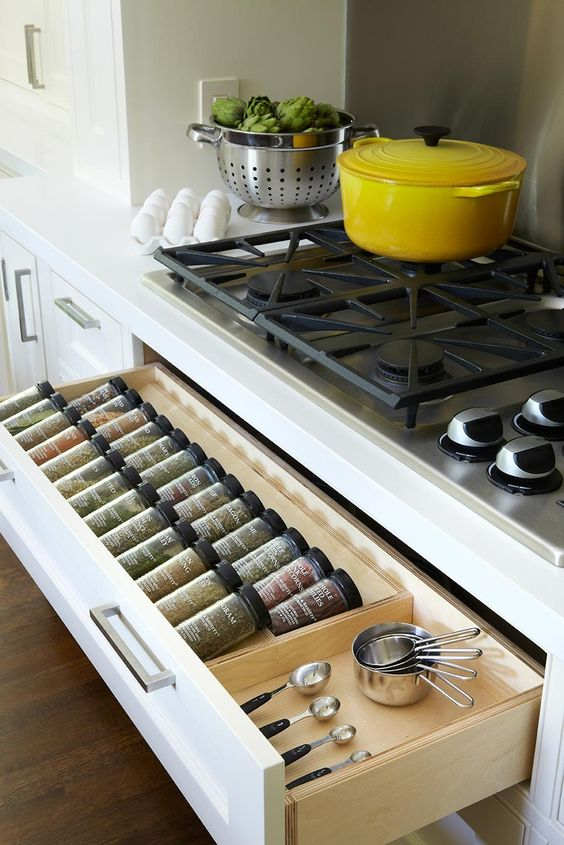 Convert faux drawer front under cooktop into a convient spice drawer. Great way to make use of that wasted space. Anne Hepfer Designs.