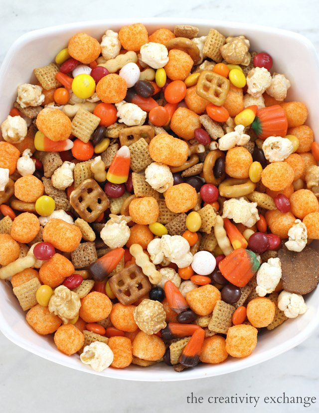 Halloween Snack Mix with cheese balls, candy corn, m&m's and cheddar chex.