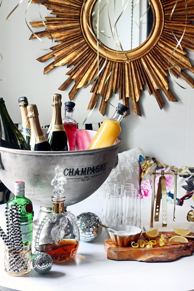 Creative ways to display and decorate with champagne buckets.