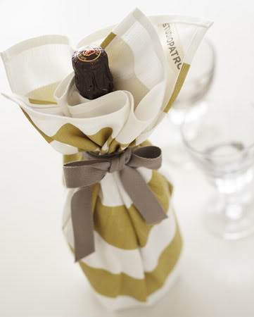 Wrap a bottle of wine with a pretty tea towel. Quick gift idea.
