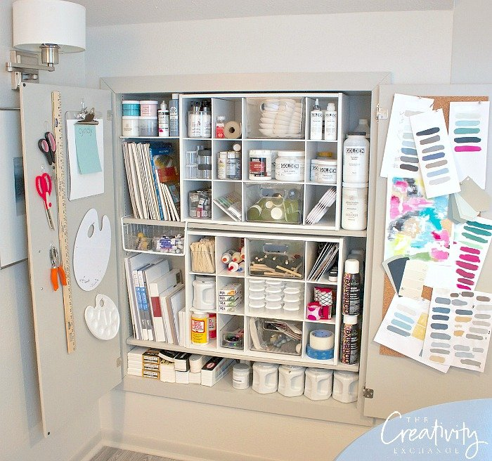 Creative craft and paint cabinet organizing.