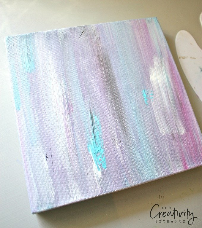 DIY heart acrylic painting tutorial. Begin with a paint wash