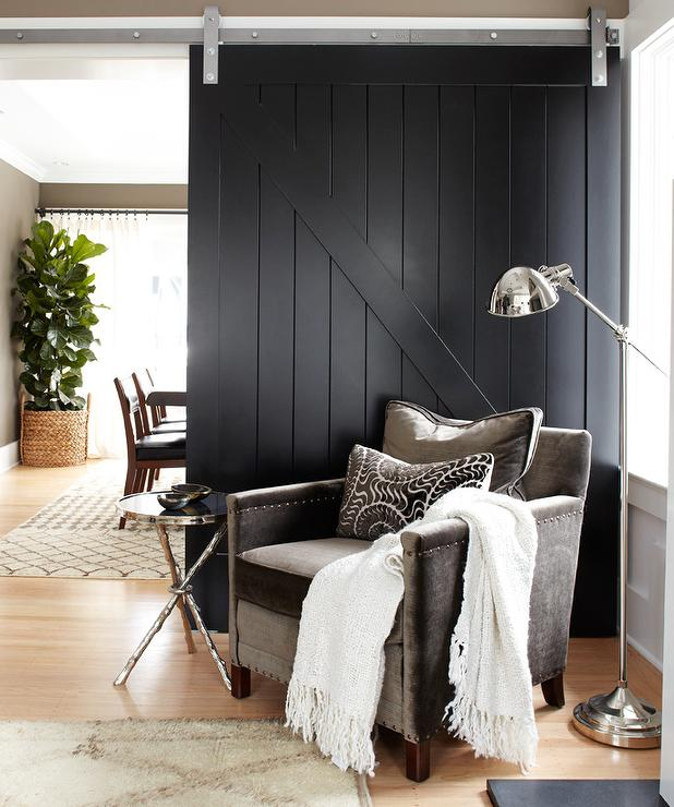 Sliding barn door painted in black Benjamin Moore.