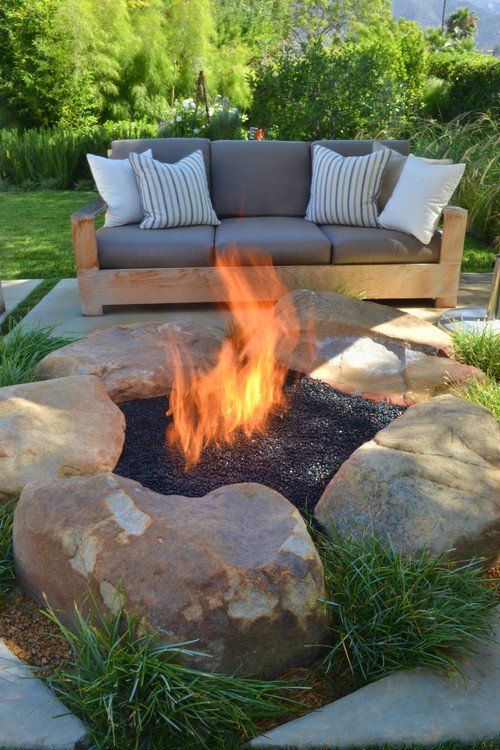 contemporary patio with rock fire pit. Jeffrey Gordon Smith