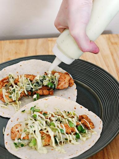 These spicy Ancho Chicken Tacos with Cilantro Slaw and Avocado Cream ...