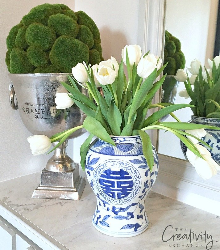 Ginger jars with the lid removed are a creative vessel for flowers.