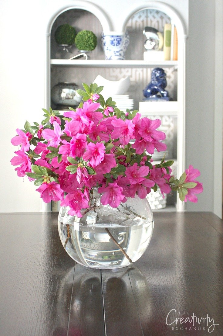 Large round glass globes are a great way to display flowers and branches from yard clippings.
