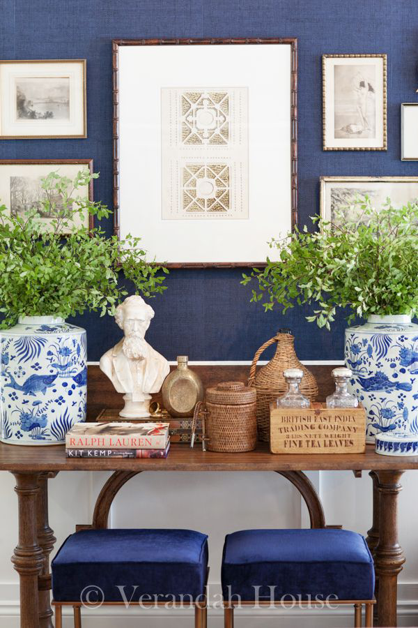 Greenery clippings in blue and white ginger jars.