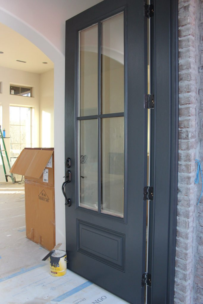 Door color is painted with Wrought Iron from Benjamin Moore. Gray in the base keeps the black from being too harsh.