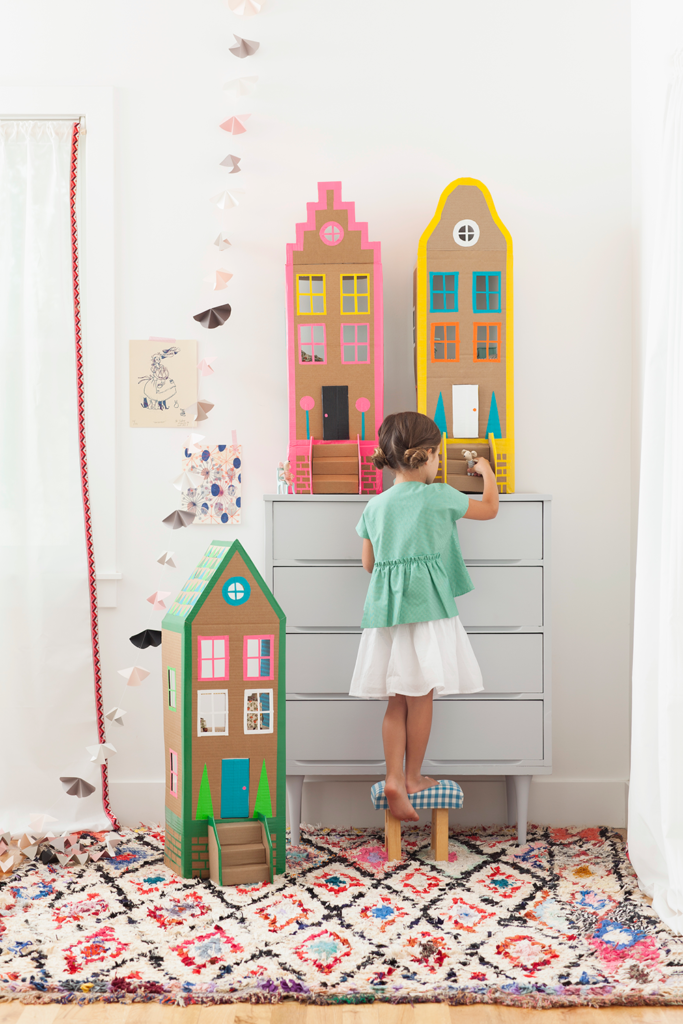 Create a dollhouse out of cardboard.