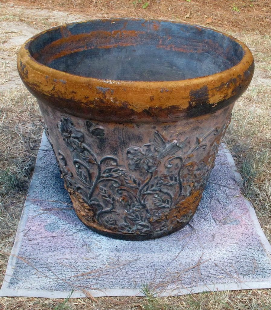 Don't throw out out beat up fiberglass garden pots. You can update them instantly with paint.