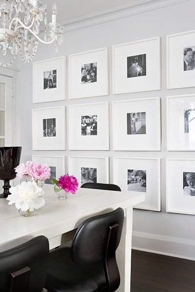 Black and white photos framed in large white mats.