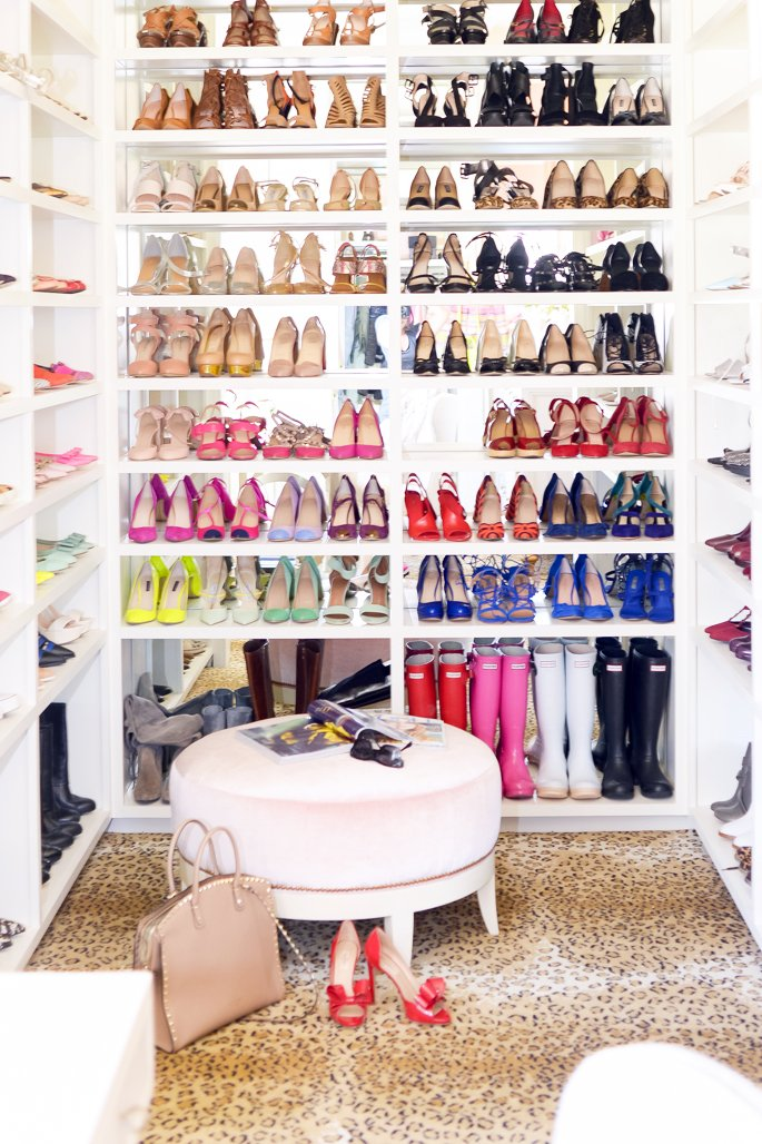 Floor to ceiling shoe shelving.