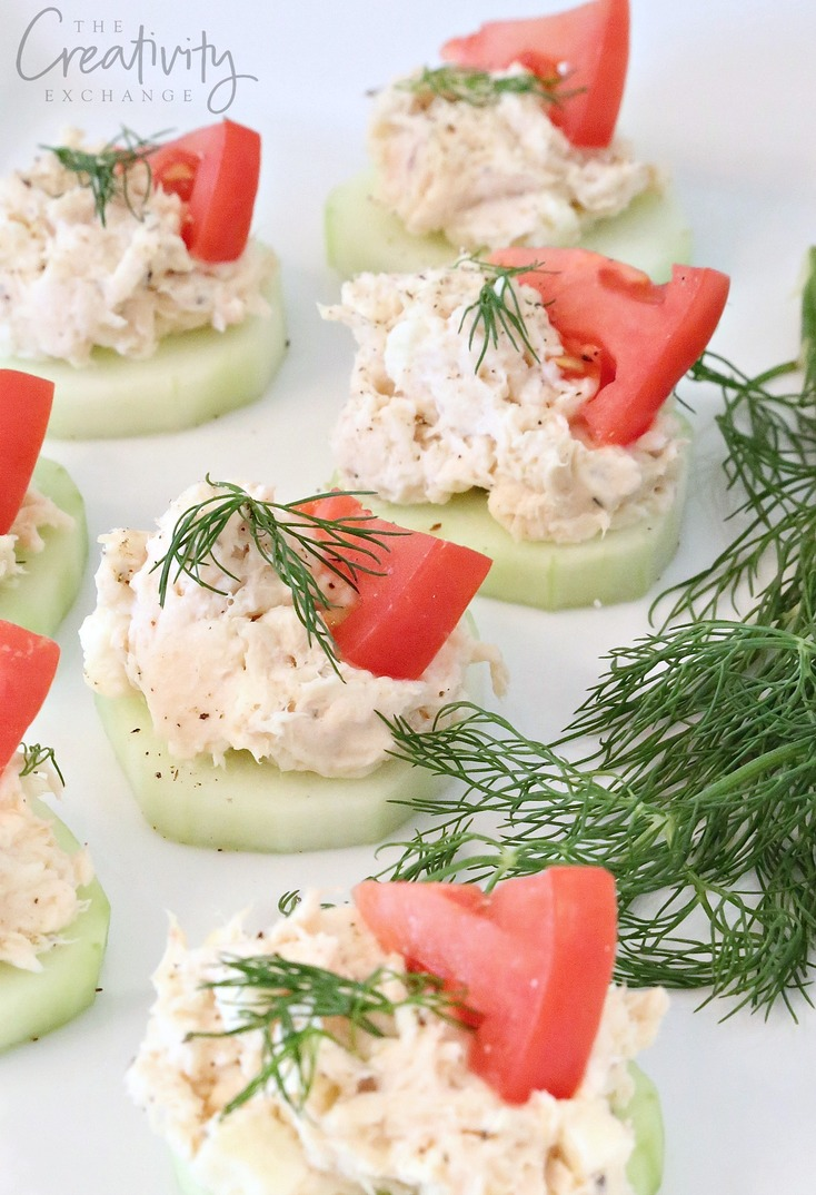 Greek chicken salad bites on cucumber slices. Made with chicken, feta and fresh dill.