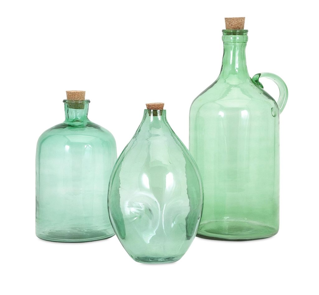 Green glass jugs in various sizes are great for layering bookshelves. Available on Amazon.