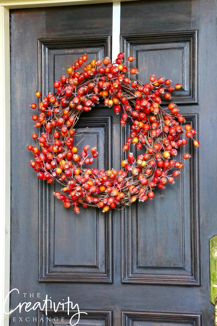 Fall wreath made with faux persimmon branches.