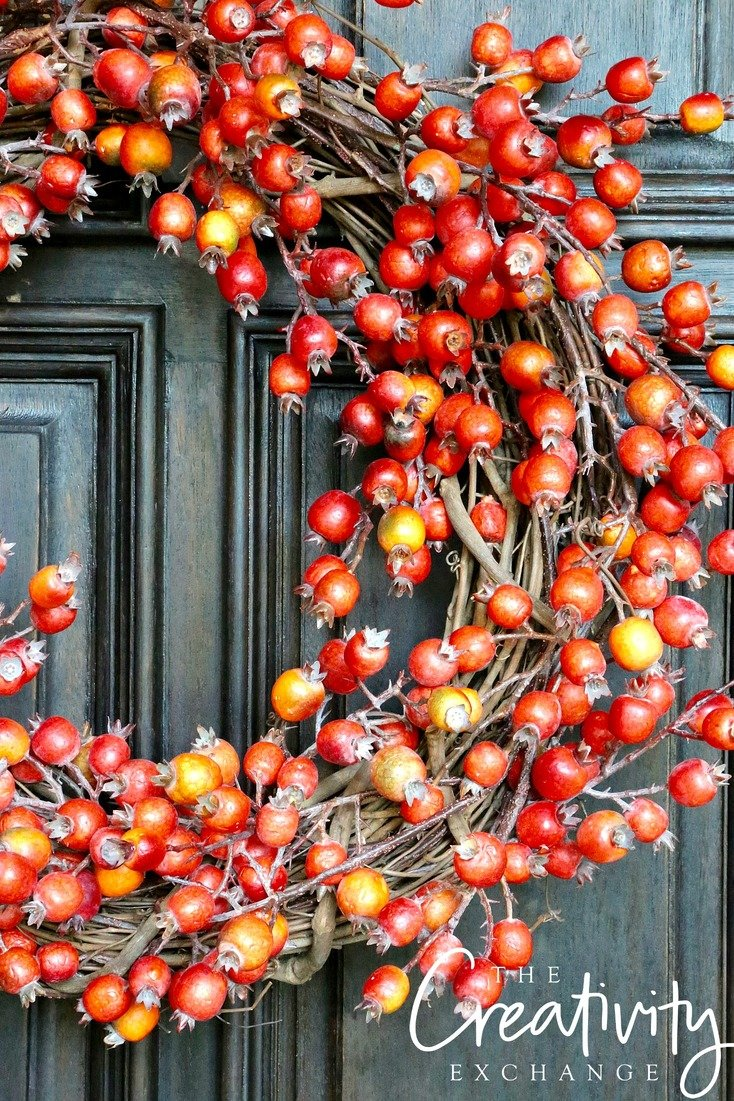Fall wreath made with faux persimmon