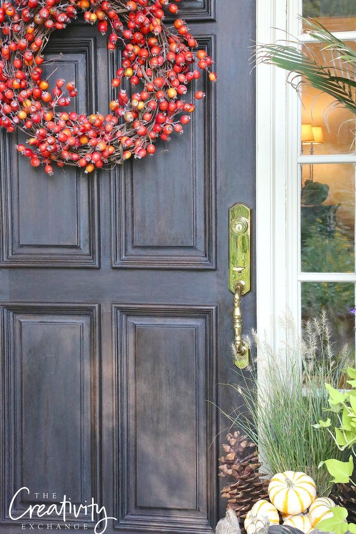 Solid wood front door refinished with Kwikset door hardware and lock.