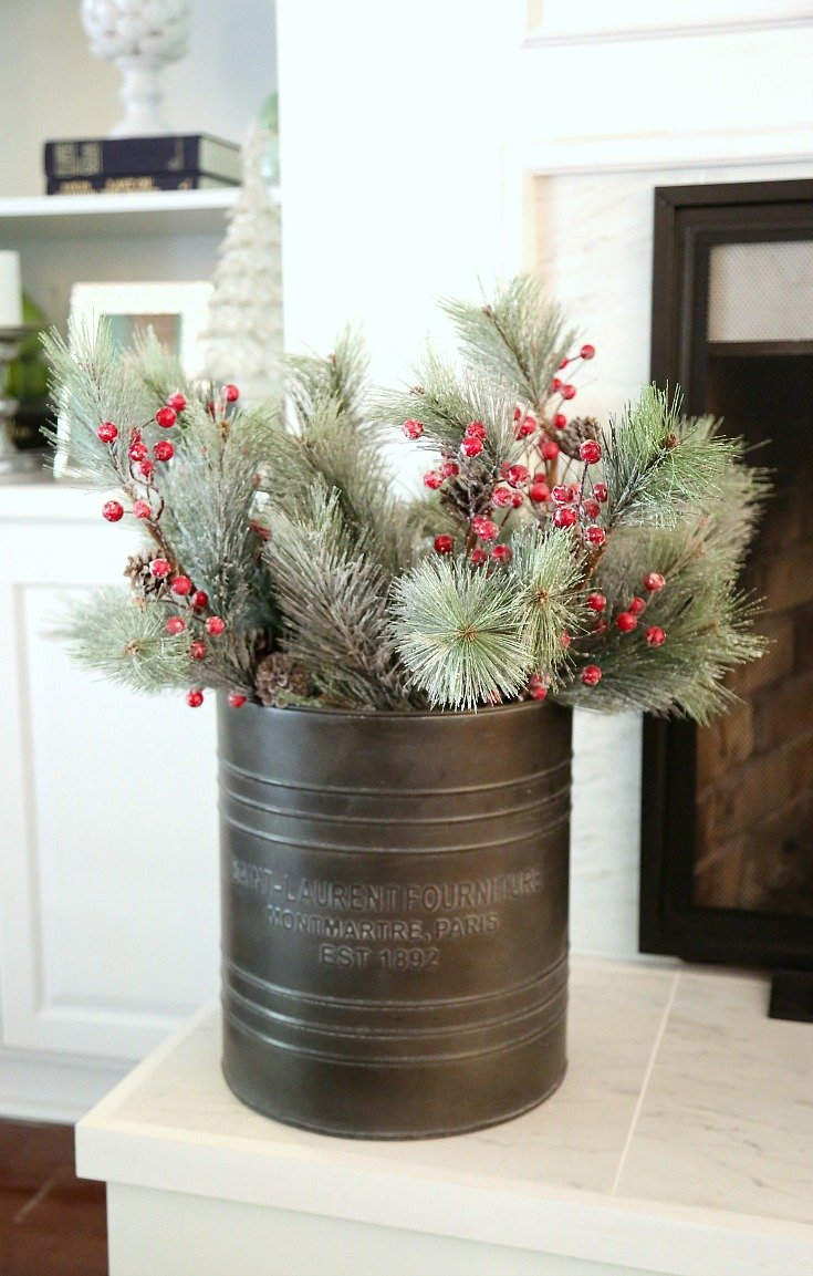 Slip sprigs and greenery into buckets and baskets