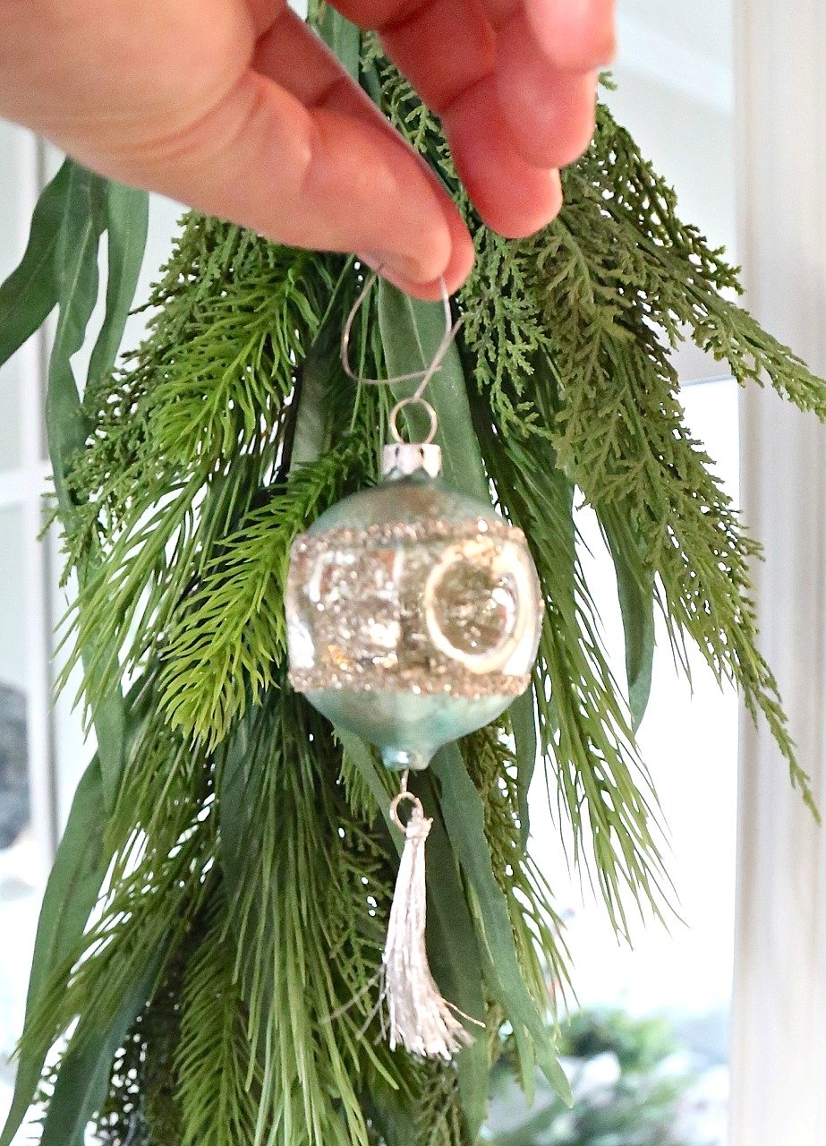 Use a Christmas Ornament Hanger as Wire.